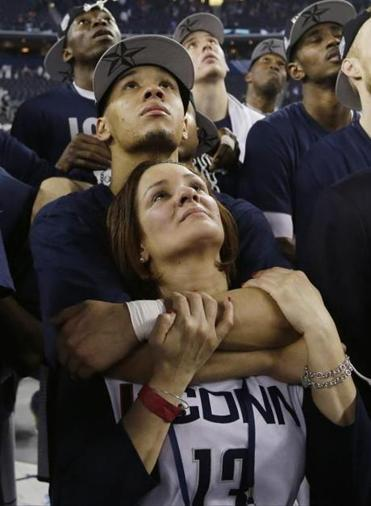 Shabazz Napier embraced his mother, Carmen Velasquez, during a celebration after winning the NCAA Final Four in Texas.